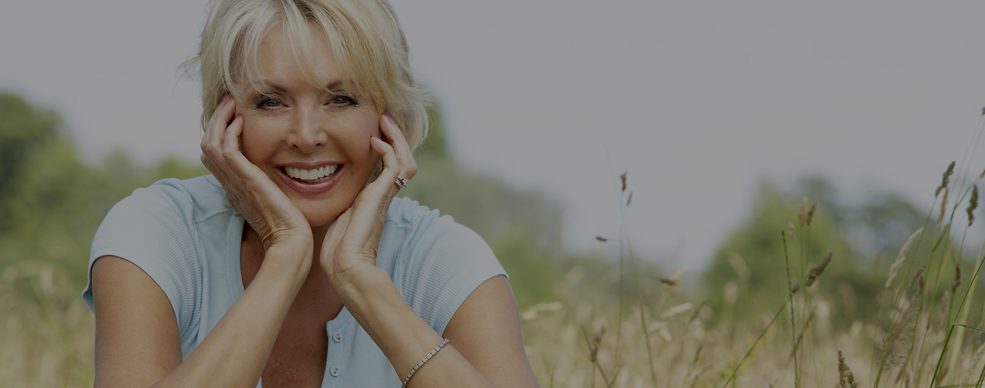 Mature Woman Sitting in a Field